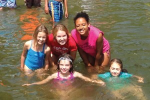 French overnight campers and staff swimming