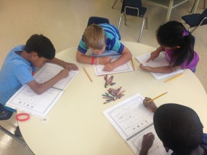 French campers coloring their activities book