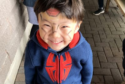 Camper smiling with face paint on