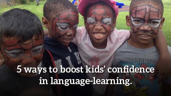 """4 campers smiling with Spiderman facepaint. Text says """"5 ways to boost kids' confidence in language learning."""""""